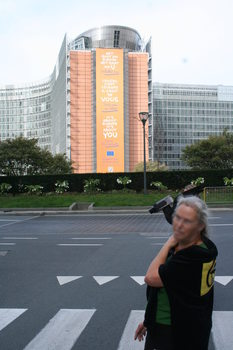 [Picture: Camera raven in front of EU building with sign saying: It's about Europe, it's about you]